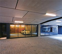 Individual garages with clear glazed doors flank the central access way.Image: Peter Bennetts.