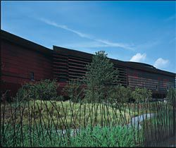 External views of the museum set among the wild gardens designed by Gilles Clément. Images: Philippe Ruault