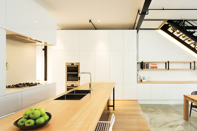 "The kitchen is like a ""floating element"" – the edges of its joinery have been pulled in to allow black sprinkler pipes to slide into the space."
