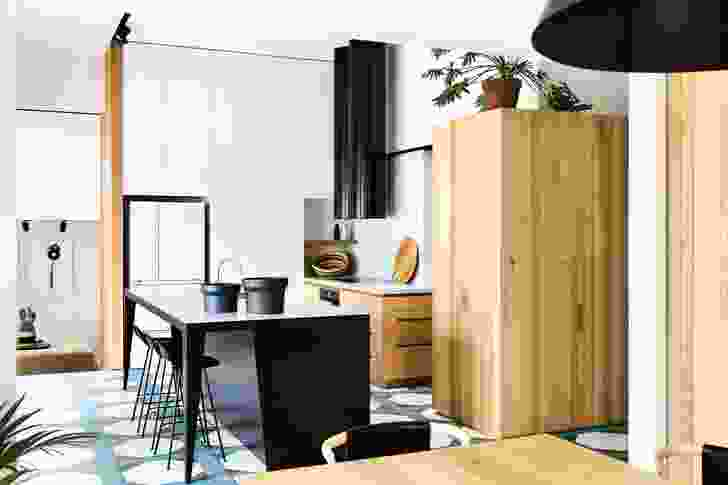 The kitchen's neat composition echoes the geometric forms of its patterned tiles. Artwork: Julian Hocking.