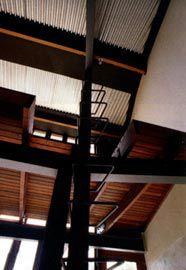 Ladder to the store above the northern-most office space, showing the enviropanel ceiling. Photographs Des Smith.