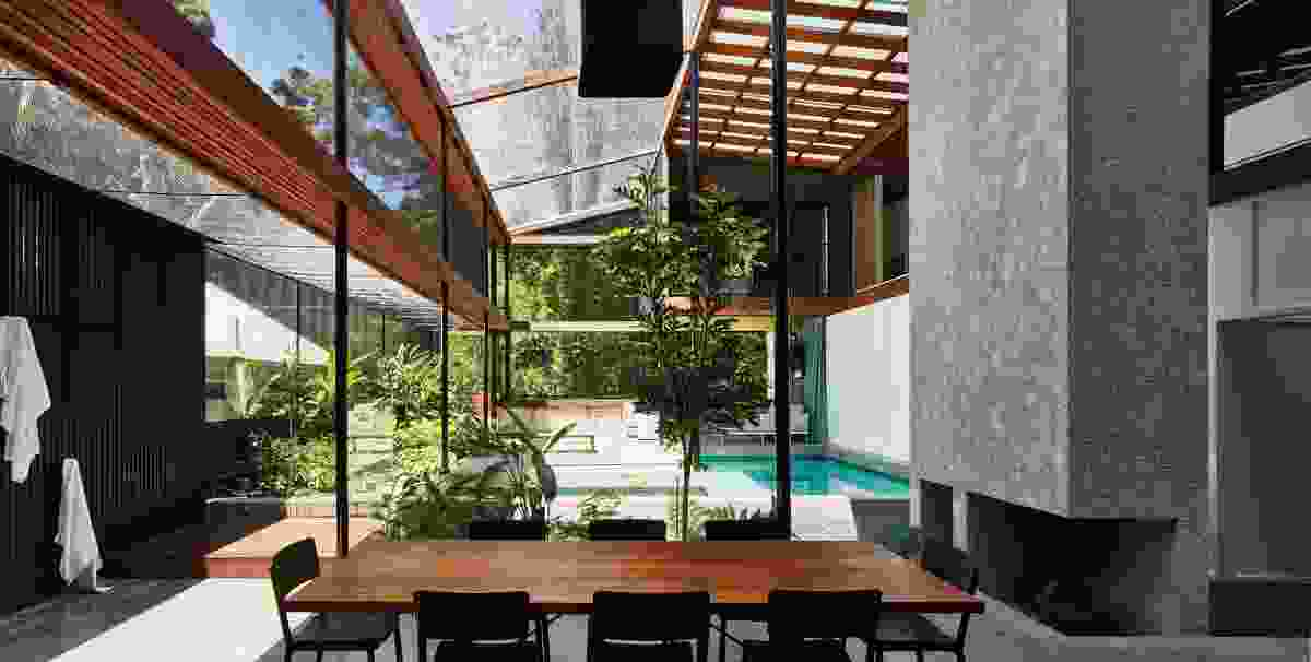 Slender steel columns support exposed ironbark beams that frame the roof and shadecloth canopy.