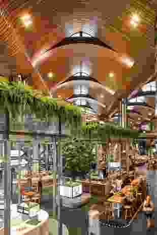 The Kitchens consists of two floor levels inserted into the large volume of the market hall and has been conceived to create a theatrical experience like that of a street market.
