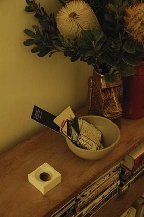 """A Gift"" – a pebble-like copper keepsake in a ceramic box."