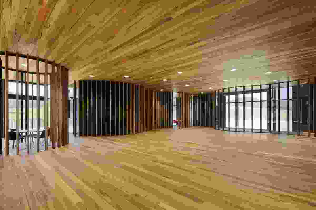 In the timber interior of the hall vertical screens create smaller spaces.
