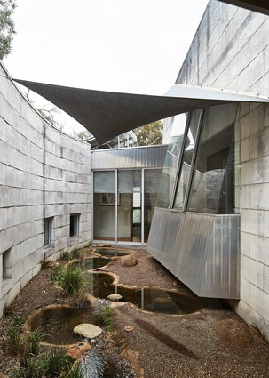 "The architects offered a design ""with some surprises,"" including the central courtyard featuring a series of ponds."