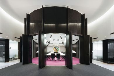 A bulging wall of tall, black columns surrounds the Mandala Room.
