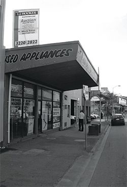 The shopfront as it appeared in 2008, prior to restoration. Photograph