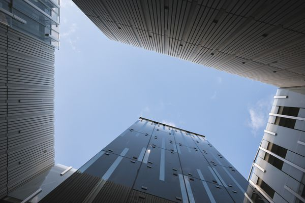Looking up from the inner courtyard, one sees Auckland's blue sky dramatically framed between the roof lines of the buildings.