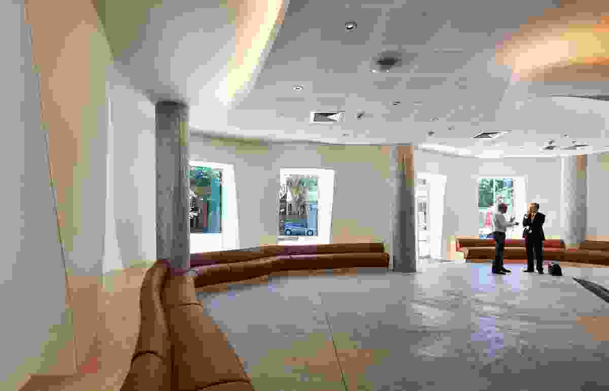 Sinuous banquette seating lines the ground-floor cafe area.