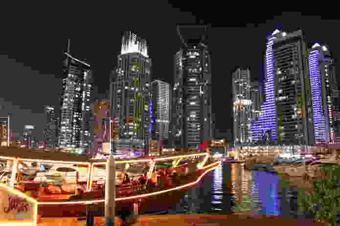 """""""Traditional"""" dhows ply the Marina as dinner-cruise entertainment along with other smaller boats that act as water-taxis."""
