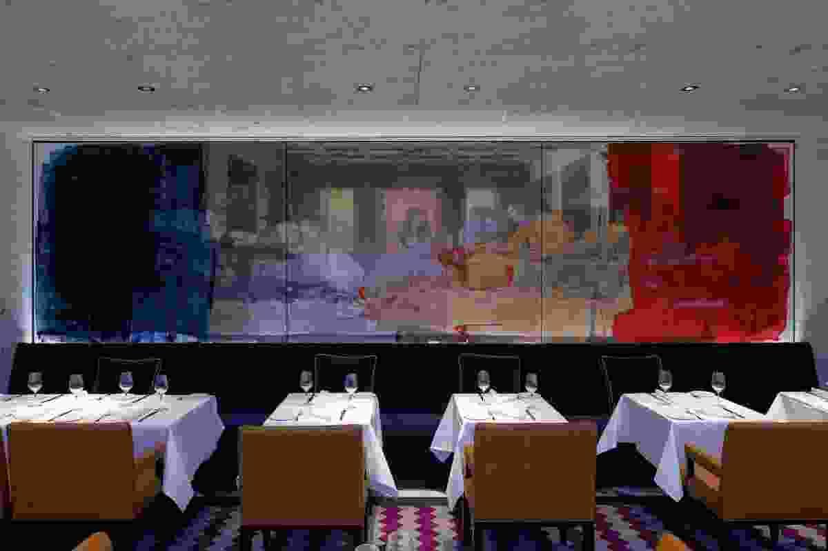 A brashly coloured digital print of <em>The Last Supper</em> in the dining room.