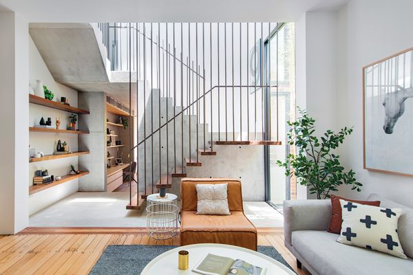 A new staircase in a central atrium marks the transition from old to new in a robust palette of concrete, recycled timber, steel and glass. Artwork: Maricou, Silver Mare.