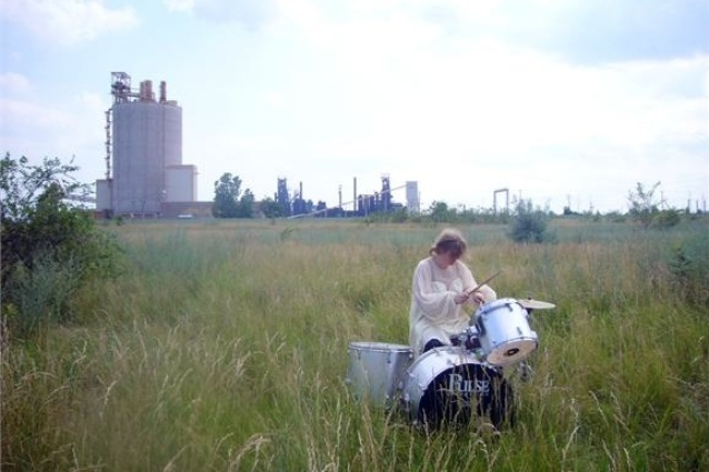 A digital video still from <em>White Drummer Detroit.</em>