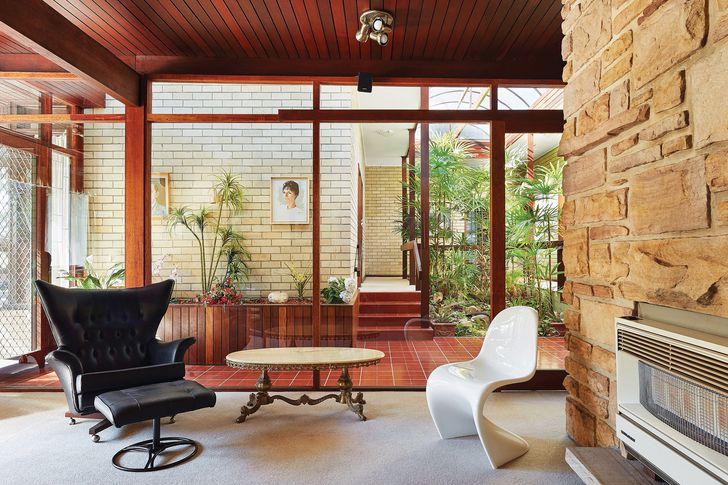 In the family living area, a wall of sandstone serves to ground the space.