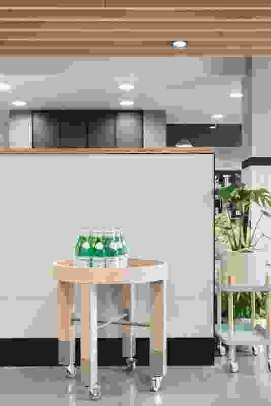 Custom designed by We Are Huntly, round display tables feature robust stainless steel socks and are topped with mint-coloured mesh.