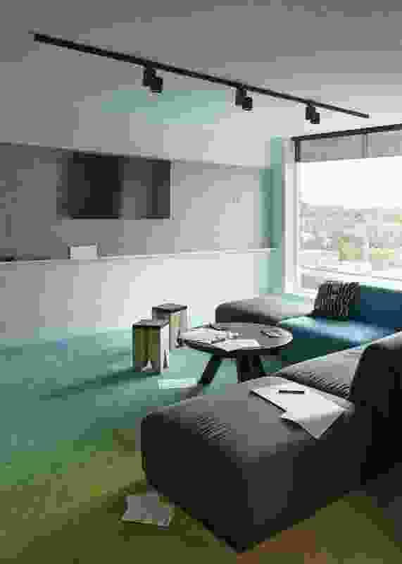 The corner meeting room facilitates brainstorming sessions.