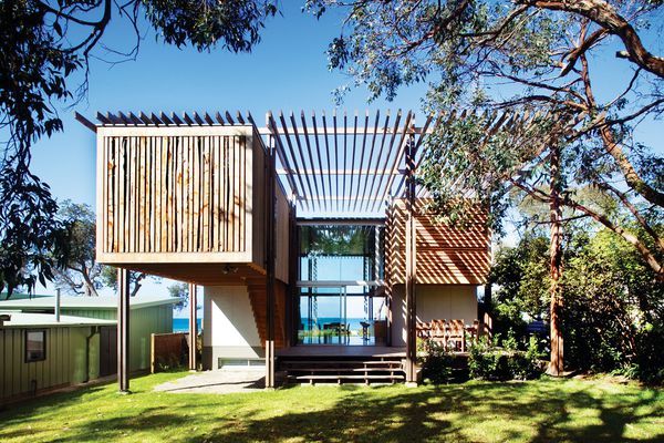 The main space is a double-height volume, with a ply-clad capsule suspended either side.