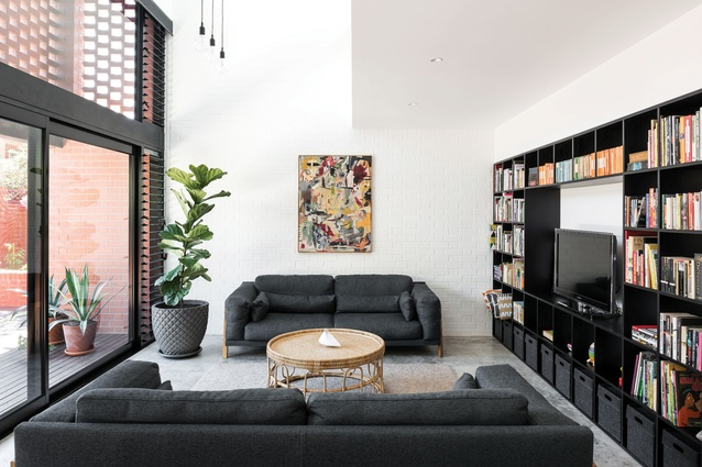 Honed concrete floors and white-painted brick walls provide a neutral and tactile base palette. Artwork: Jordy Hewitt.