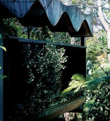 Reason and emotion. The sinusoidal ceiling/roof and hovering concrete panel tucked into the bush.