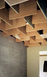 The timber waffles and baffles of the original ceiling. Image: John Gollings