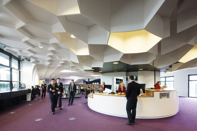 An array of hexagonal motifs extrude down from the ceiling in the library.