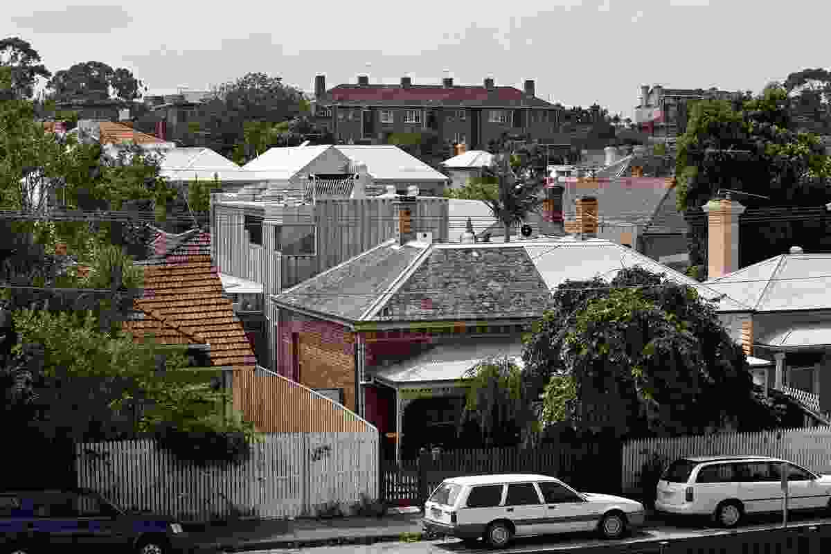 The Webb House in its St Kilda context, showing a range of active sustainable technology on the roof.