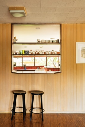Pale, vertical timber boards line the informal family room that abuts the kitchen.
