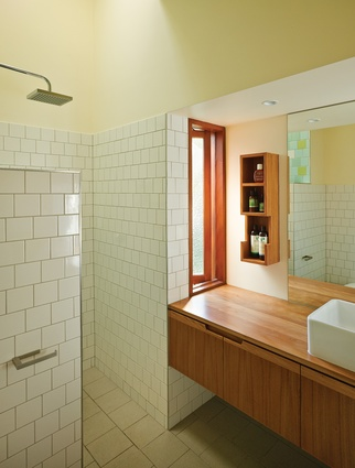 A bathroom skylight allows the owners to bathe in the warmth of natural light.