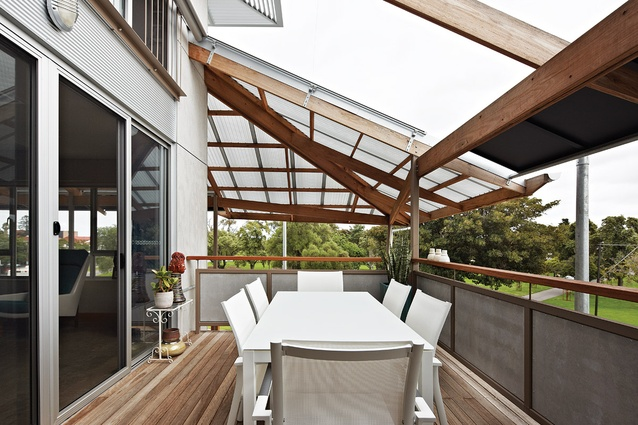 Pergolas, screening and operable sunshades protect the balconies.
