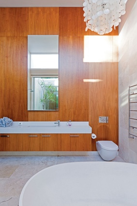 The bathroom, located in the original house, features American walnut veneer panels.