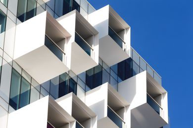 The projecting balconies of the Upper House by Jackson Clements Burrows add dynamism and depth to the building envelope.