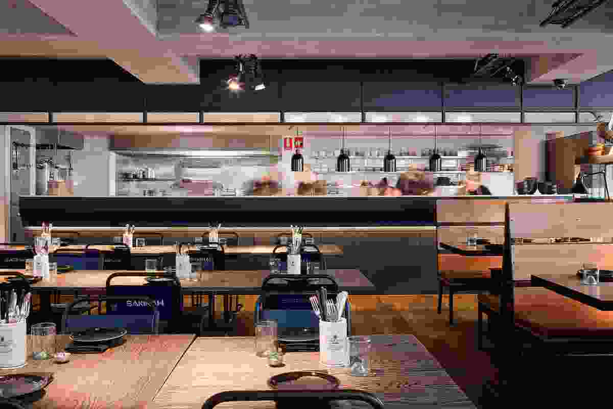 Backstage: the open kitchen at rear.