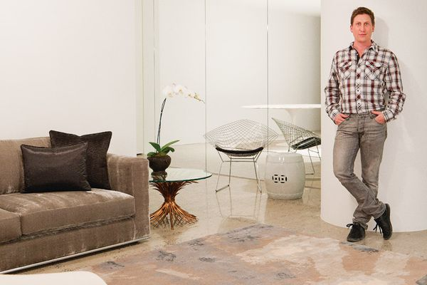 """David Hicks with his Cadrys Sun rug, which captures """"a warm, intimate feeling reminiscent of a silver sunburst with a flare at its centre."""""""