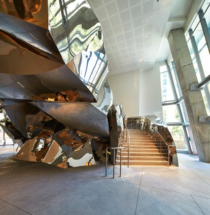 A stainless steel stair in the main lobby – manufactured by Urban Art Projects – is one of the sculptural forms within the building.