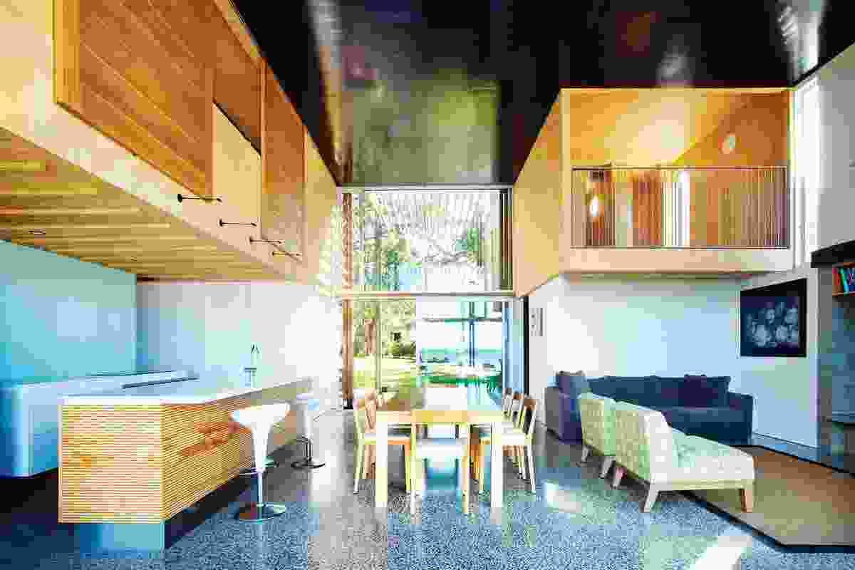 The ply-lined capsules are upstairs bedrooms that look over the main living space.