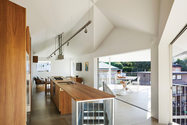 Sliding doors are carefully detailed to ensure that the surface finishes of burnished concrete and fibre-cement panels are continuous between interior and exterior