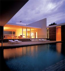 Looking over the lap pool to the central volume housing the living spaces.