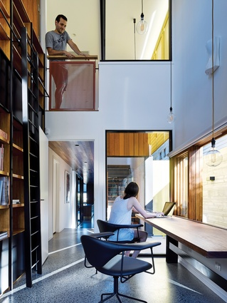 Strengthening a sense of verticality is the two-storey bookshelf formed of Tasmanian blackwood and steel.