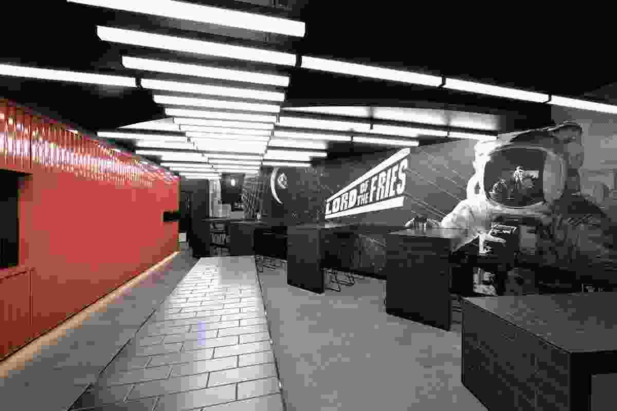 The futuristic wall art is designed by Brendan Elliott of B&Co.