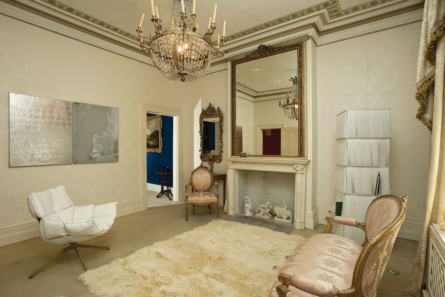 Johnston's sitting room and Mirror, Mirror no. 2 (2008–09) featuring B&B; Italia armchair by Patricia Urquiola and Edra bookcase.