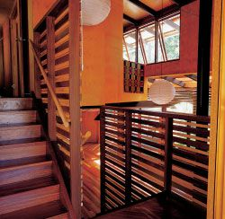 The Taringa House. Entry on the half level. Stairs lead up to bedrooms and down to living room.