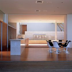 Kitchen and dining areas with the garden court beyond.