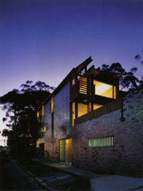 """Oblique view of the main street facade """"city wall"""", with the house above and behind. Image: Patrick Bingham-Hall."""