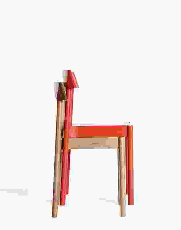 NOMI Woodstack Chairs in natural American oak and red.