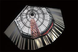 Looking up at Melbourne Central's old shot tower, sheltered by the Kisho Kurokawa/Bates Smart signature cone, now framed by the Ashton Raggatt McDougall bar code motif.