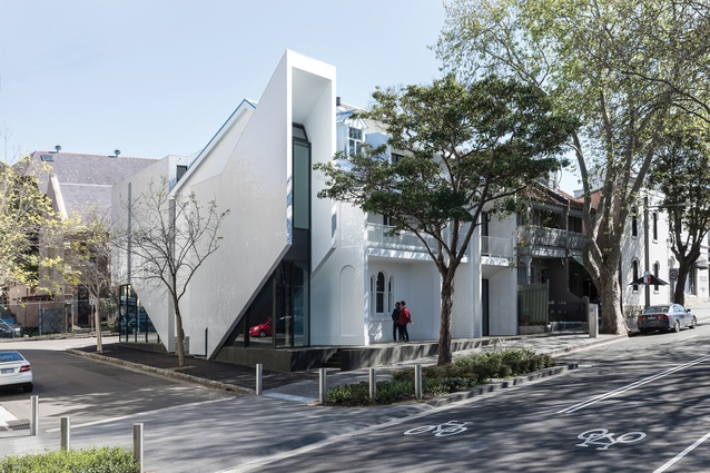 White tile cladding applied to the new component is reminiscent of the Sydney Opera House as well as the long association that Surry Hills has with the Portuguese community.