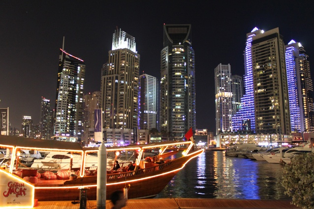 """Traditional"" dhows ply the Marina as dinner-cruise entertainment along with other smaller boats that act as water-taxis."