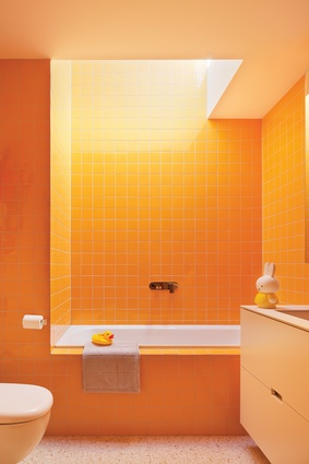 Uplifting colours are used in the bathrooms at Kate's House, amplified by natural light from above.