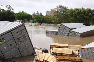 Flooded shipping container park on 13 January 2011, in St Lucia, Brisbane.
